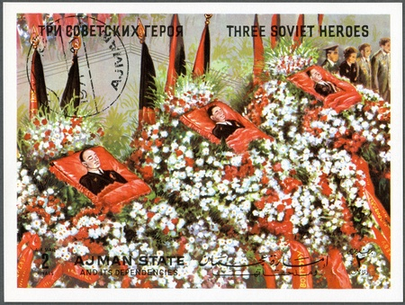 AJMAN - CIRCA 1971: A stamp printed in Ajman shows Three Soviet Heroes, circa 1971 Stock Photo - 15156875