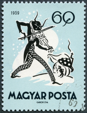 postal card: HUNGARY - CIRCA 1959: A stamp printed in Hungary shows The Cricket and the Ant, circa 1959 Editorial
