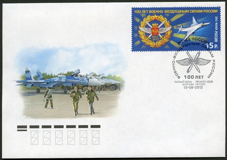 RUSSIA - CIRCA 2012: A stamp printed in Russia shows emblem of celebration of 100th anniversary of Air Force and Tu-160, circa 2012 Stock Photo - 15203981