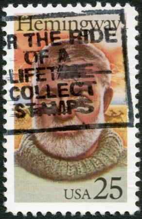 UNITED STATES OF AMERICA - CIRCA 1989: A stamp printed in USA shows Ernest Hemingway (1899-1961), Nobel Prize-winner for Literature, circa 1989 Stock Photo - 15318305