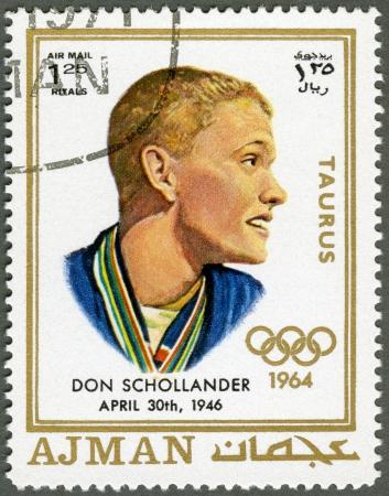 AJMAN - CIRCA 1970: A stamp printed in Ajman shows Donald Schollander (born 1946), circa 1970 Stock Photo - 15461124