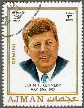 AJMAN - CIRCA 1970: A stamp printed in Ajman shows John F. Kennedy (1917-1963), circa 1970