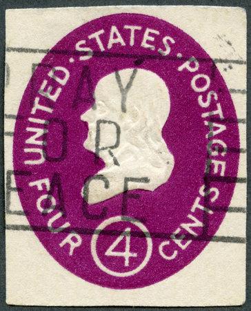 satirist: USA - CIRCA 1952: A stamp printed in USA shows President Benjamin Franklin, circa 1952