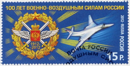 RUSSIA - CIRCA 2012  A stamp printed in Russia shows emblem of celebration of 100th anniversary of Air Force and Tu-160, circa 2012 Stock Photo - 15670763
