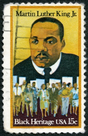 marchers: USA - CIRCA 1979  A stamp printed in United States of America shows Martin Luther King Jr   1929 - 1968  and civil rights marchers, Black heritage, circa 1979