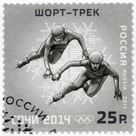 olympic symbol: RUSSIA - CIRCA 2011: A stamp printed in Russia shows XXII Olympic Winter Games in Sochi 2014, Olympic winter Sports, Short track, circa 2011
