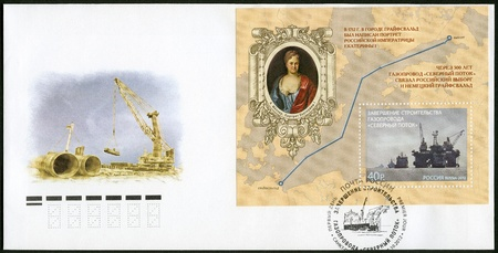 RUSSIA - CIRCA 2012  A stamp printed in Russia shows Completion construction of the pipeline  Stock Photo - 15724094