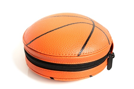 CD case in shape of basket ball on a white background photo
