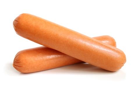 perro comiendo: Salchichas aislados en un fondo blanco Foto de archivo