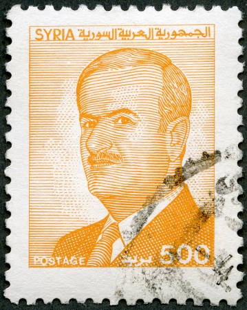 SYRIA - CIRCA 1986  A stamp printed in Syria shows President Sukarno  1930-2000 , circa 1986 Stock Photo - 15855206