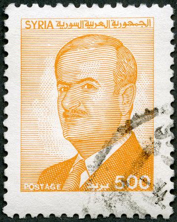 al assad: SYRIA - CIRCA 1986  A stamp printed in Syria shows President Sukarno  1930-2000 , circa 1986
