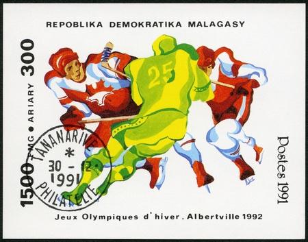 xvi: MALAGASY REPUBLIC - CIRCA 1991: A stamp printed in Malagasy (Madagascar) shows Three hockey players, 1992 Winter Olympics, Albertville, circa 1991