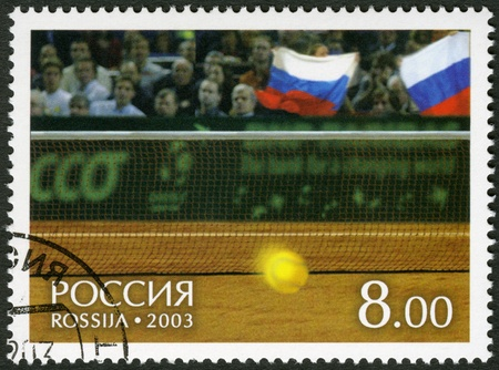 postmail: RUSSIA - CIRCA 2003: A Stamp printed in Russia shows Tennis ball and fans on tribunes, on court of a hall of Bercy - Winners of the Davis Cup 2002, circa 2003 Editorial