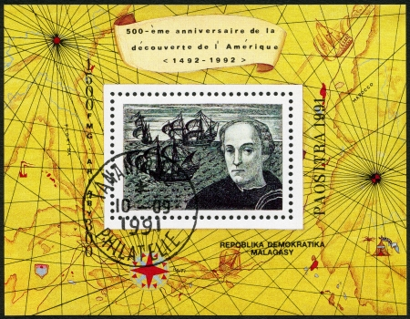 MALAGASY REPUBLIC - CIRCA 1991: A stamp printed in Malagasy (Madagascar) devoted to 500th anniversary of the discovery of America, shows Map and picturing ships and Christopher Columbus, circa 1991