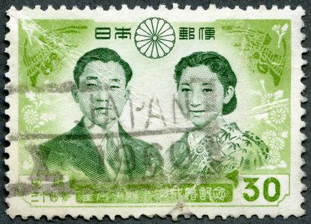 JAPAN - CIRCA 1959: A stamp printed in Japan shows Prince Akihito and Princess Michiko, circa 1959