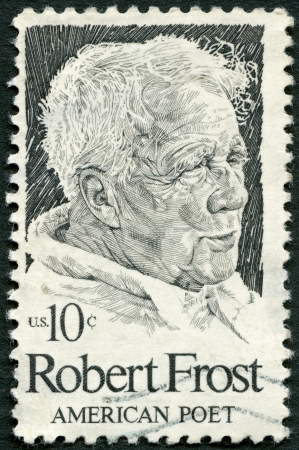 robert: UNITED STATES OF AMERICA - CIRCA 1974: A stamp printed in USA shows Robert Frost (1874-1963), American poet, circa 1974