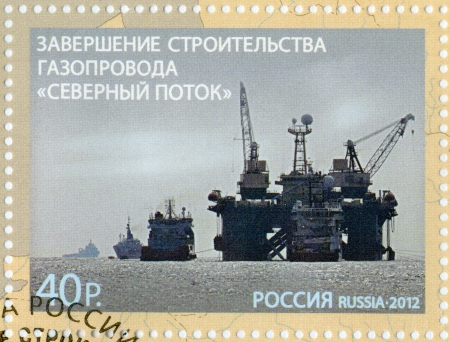 RUSSIA - CIRCA 2012: A stamp printed in Russia shows Completion construction of the pipeline  Stock Photo - 16127781