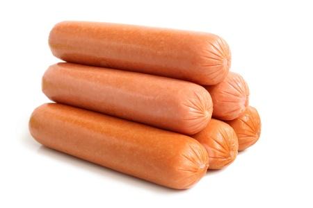 perro comiendo: Salchichas en un fondo blanco