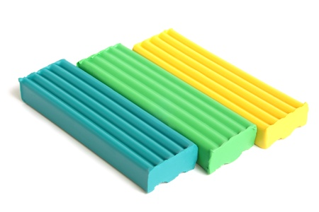 Color children's plasticine on a white background photo