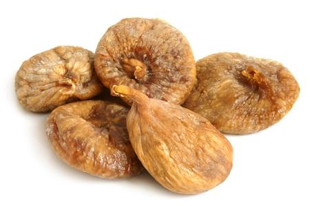 legumbres secas: Higos secos sobre un fondo blanco