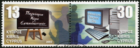 CYPRUS - CIRCA 2002: A stamp printed in Cyprus shows Blackboard and teachers, Computer and teachers, International Teacher's Day, circa 2002 Stock Photo - 16239372