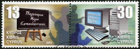 CYPRUS - CIRCA 2002: A stamp printed in Cyprus shows Blackboard and teachers, Computer and teachers, International Teacher's Day, circa 2002 Stock Photo - 16239372