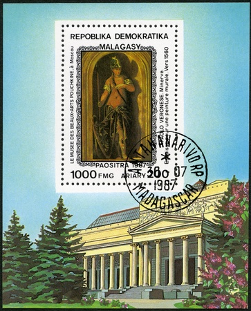 MALAGASY REPUBLIC - CIRCA 1987: A stamp printed in Malagasy (Madagascar) shows Minerva (1560), by Paolo Veronese (1528-1588), series Paintings in the Pushkin Museum, Moscow, circa 1987 Stock Photo - 16239394