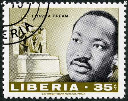 LIBERIA - CIRCA 1968  A stamp printed in Liberia shows Martin Luther King Jr   1929 - 1968 , American civil rights leader, and Lincoln monument by Daniel Chester French, circa 1968