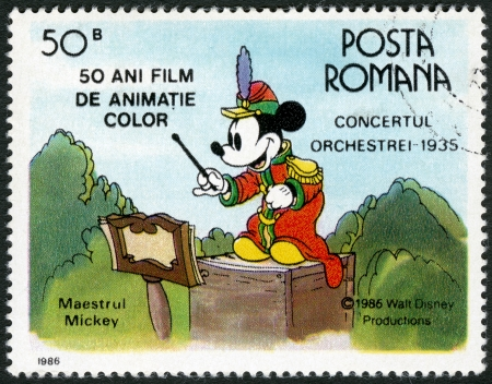 mickey: ROMANIA - CIRCA 1986: A stamp printed in Romania shows Mickey Mouse, Walt Disney characters in the Band Concert, 1935, devoted fifty years of Color Animated Films, series, circa 1986 Editorial