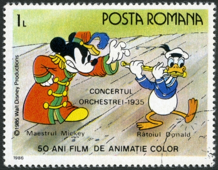 ROMANIA - CIRCA 1986: A stamp printed in Romania shows Mickey and Donald, Walt Disney characters in the Band Concert, 1935, devoted fifty years of Color Animated Films, series, circa 1986