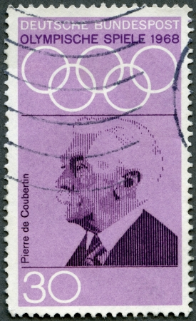 coubertin: GERMANY - CIRCA 1968: A stamp printed in Germany shows Pierre de Coubertin (1863-1937), dedicated to 19th Olympic Games, Mexico City, 1012-27, circa 1968