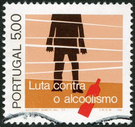 detriment: PORTUGAL - CIRCA 1977  A stamp printed in Portugal shows Alcoholic and Bottle, symbolic figure of broken life, circa 1977