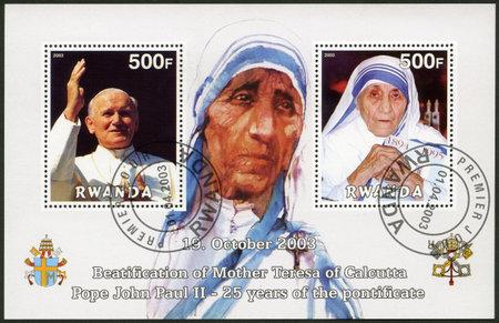 beautification: RWANDA - CIRCA 2003: A stamp printed in Rwanda shows Beautification of Mother Teresa of Calcutta and Pope John Paul II - 25th Anniversary of the Pontificate, circa 2003
