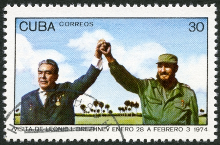 CUBA - CIRCA 1974: A stamp printed in Cuba shows Leonid Brezhnev and Fidel Castro, devoted Visit of Leonid I. Brezhnev to Cuba, January 28-February 3, circa 1974 新聞圖片