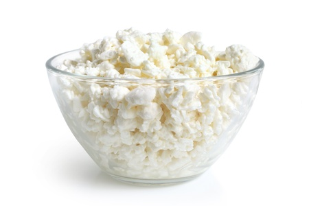 cottage cheese: Cottage cheese in glass bowl on a white background Stock Photo