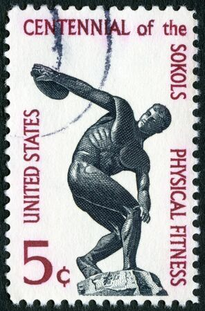 founding: USA - CIRCA 1965: A stamp printed in USA shows Discus thrower, Importance of physical fitness of the founding of the Sokol (athletic) organization in America, circa 1965
