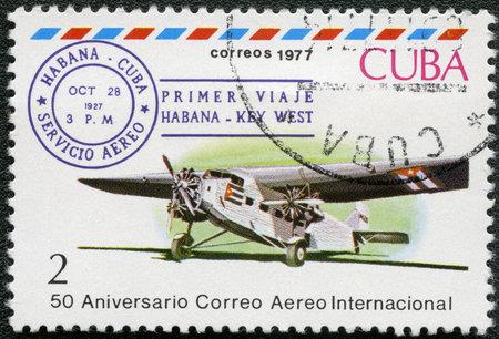 CUBA - CIRCA 1977 A stamp printed in Cuba shows Three-engine plane and Cuba-Key West 1st flight cancel, Oct 28, 1927, series International Airmail Service, 50th Anniversary, circa 1977