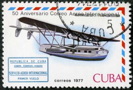 cachet: CUBA - CIRCA 1977  A stamp printed in Cuba shows Flying boat and international airmail service 1st flight cachet, series International Airmail Service, 50th Anniversary, circa 1977 Editorial
