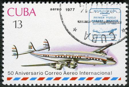 CUBA - CIRCA 1977  A stamp printed in Cuba shows vintage airplane and Havana-Mexico cachet, series International Airmail Service, 50th Anniversary, circa 1977