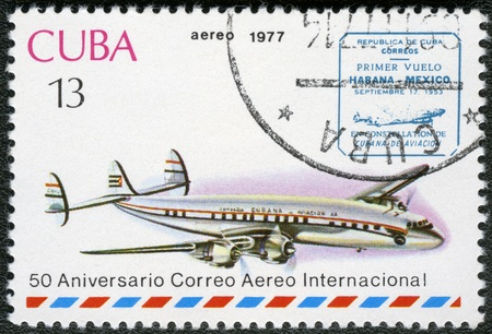cachet: CUBA - CIRCA 1977  A stamp printed in Cuba shows vintage airplane and Havana-Mexico cachet, series International Airmail Service, 50th Anniversary, circa 1977