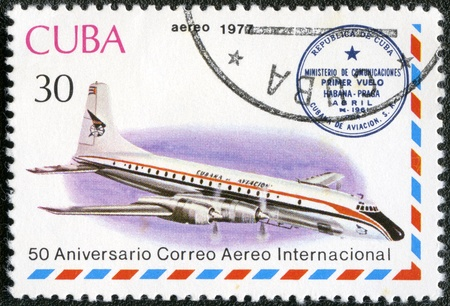 postmail: CUBA - CIRCA 1977  A stamp printed in Cuba shows vintage airplane and Havana-Prague cachet, series International Airmail Service, 50th Anniversary, circa 1977