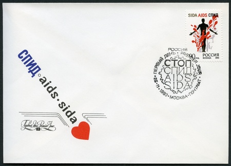 RUSSIA - CIRCA 1993: A stamp printed in Russia shows Stop AIDS! A man's figure in a colorful composition, circa 1993 Stock Photo - 16628254