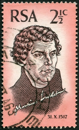 perforated stamp: SOUTH AFRICA - CIRCA 1967  A stamp printed in South Africa shows Martin Luther  1483-1546 , 450th anniversary of the Reformation, circa 1967