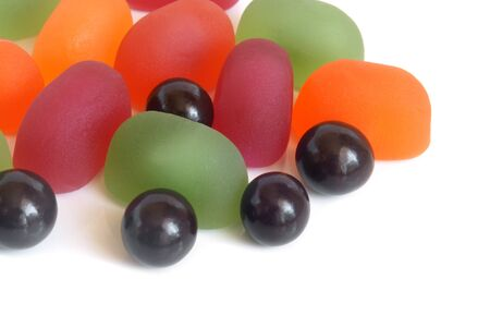 Fruit jelly and chocolate balls on a white background Stock Photo - 16665011