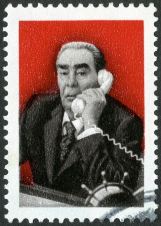USSR - CIRCA 1981: A stamp printed in USSR shows Leonid Ilyich Brezhnev (1906-1982), devoted 1st direct telephone link with India, circa 1981 Stock Photo - 16680003