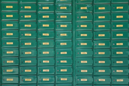 Green post boxes at post office, a horizontal picture photo