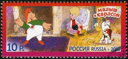 RUSSIA - CIRCA 2012: A stamp printed in Russia shows The Kid and Carlson, series Heroes of domestic cartoons, circa 2012 Stock Photo - 16721964