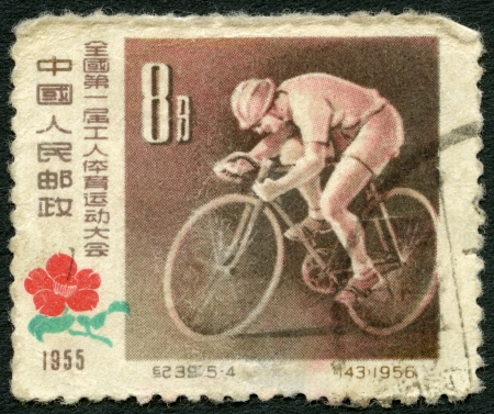 bicycling: CHINA - CIRCA 1957: A stamp printed in China shows Bicycling, First National Workers Sports Meeting, circa 1957