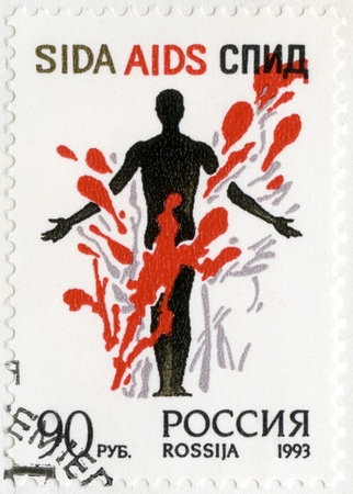 RUSSIA - CIRCA 1993: A stamp printed in Russia shows Stop AIDS! A man's figure in a colorful composition, circa 1993 Stock Photo - 16751423