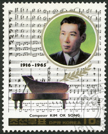 NORTH KOREA - CIRCA 1987: A stamp printed in North Korea shows Kim Ok Song (1916-1965), series Famous Composers, circa 1987 photo
